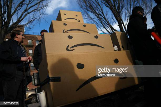 Boxes with the Amazon logo turned into a frown face are stacked up after a protest against Amazon in the Long Island City neighborhood of the Queens...