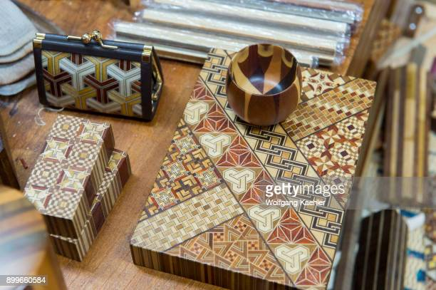 Boxes with Yosegizaiku wooden inlaid work at the Hamamatsuya a studio where wooden handicrafts are made in the Hakone area Kanagawa Prefecture Japan