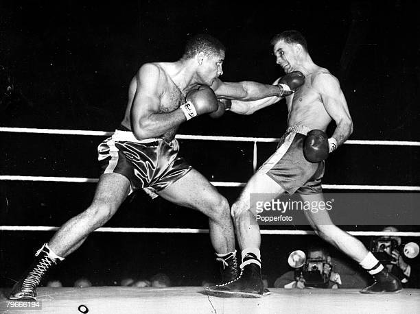 Boxing 15th October 1958 London England Zora Folley of Arizona no 1 world champion heavyweight crown uses the classic left against British boxer...