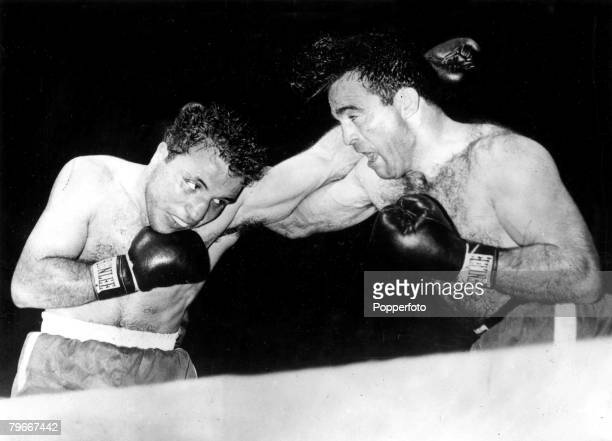 Boxing 17th June American boxer Jake La Motta The Raging Bull swaps punches with Frenchman Marcel Cerdan during their Detroit USA fight
