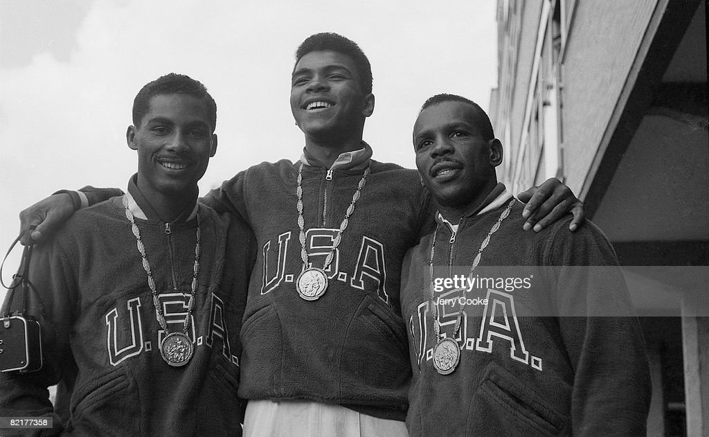 Portrait of USA Wilbert McClure (Light Middleweight), USA Cassius Clay (Light Heavyweight), and USA Eddie Crook Jr. (Middleweight) victorious with gold medals at Piazza XVII Olimpiade. Rome, Italy 8/25/1960--9/11/1960