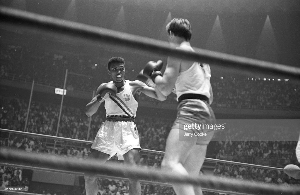 USA Cassius Clay in action during Men's Light-Heavyweight Gold Medal bout vs Poland Zbigniew Pietrzykowski at Palazzo dello Sport. Jerry Cooke X6933 TK11 R5 F22 )