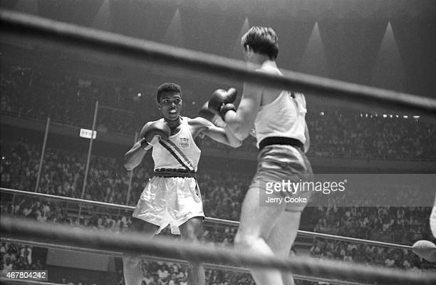 1960 Summer Olympics USA Cassius Clay in action during Men's LightHeavyweight Gold Medal bout vs Poland Zbigniew Pietrzykowski at Palazzo dello Sport...