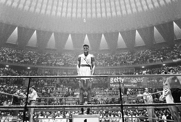 Boxing 1960 Summer Olympics USA Cassius Clay victorious on podium after winning light heavyweight gold medal View of Palazzo dello Sport stadium Rome...