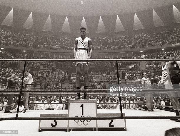 Boxing 1960 Summer Olympics USA Cassius Clay victorious on stand after winning Light Heavyweight gold medal vs Poland Zbigniew Pietrzykowski View of...