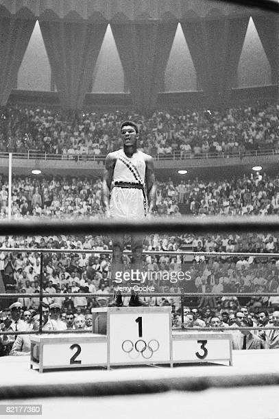 1960 Summer Olympics USA Cassius Clay victorious on stand after winning Light Heavyweight gold medal vs Poland Zbigniew Pietrzykowski View of Palazzo...