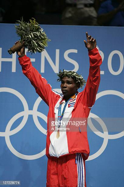 2004 Summer Olympics Cuba Guillermo Rigondeaux Ortiz victorious with medal after winning gold in Men's 54kg final vs Thailand Worapoj Petchkoom at...