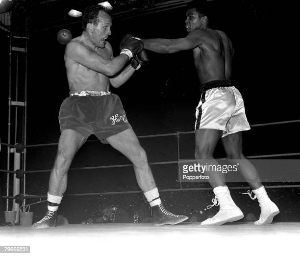 Boxing 21st May 1966 World Heavyweight Champion Cassius Clay of the USA jabs at Britain's Henry Cooper in the 2nd round of their Highbury London...