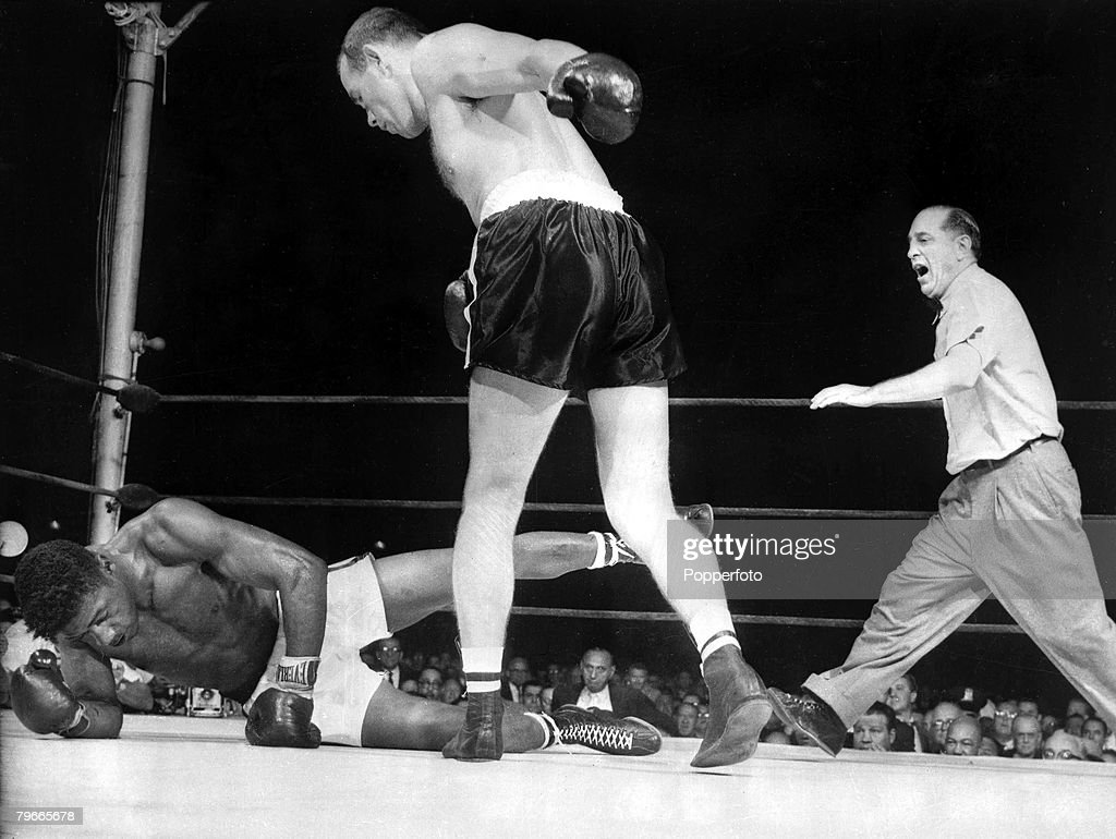 Boxing, 27 June 1959: Sweden+s Ingemar Johansson stands over the World Heavyweight Champion, American Floyd Patterson, American Referee Ruby Goldstein steps in to stop their New York Fight in the 3rd round, Patterson was knocked down 7 times in their figh : News Photo