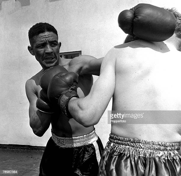 Boxing A picture of British boxer Randolph Turpin trains on top of the roof with sparring partner Pete Parsons at the Great Orme Hotel