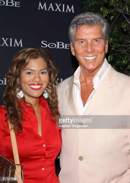 Boxing announcer Michael Buffer and wife Alina attend Maim Magazine and Sobe's Tale Slide Party at Jim Henson Studios on August 5 2004 in Hollywood...