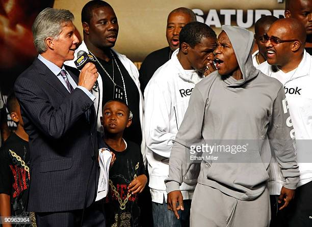 Boxing announcer Michael Buffer Koraun Mayweather boxer Floyd Mayweather Jr and his advisor Leonard Ellerbe attend the official weighin for...