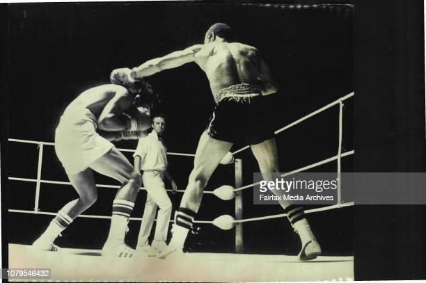 Boxing At Hordern PavillionBlakeney Mathews, of South Africa and Masahary Tsuchiya, of Japan during their bout at the Hordern Pavillion tonight....