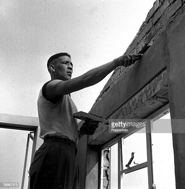 Boxing British boxer Randolph Turpin is a handyman and here he is plastering at the Great Orme Hotel