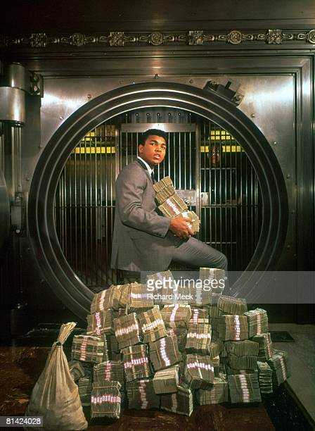 Boxing Casual portrait of heavyweight Cassius Clay with money at Bank of America Los Angeles CA
