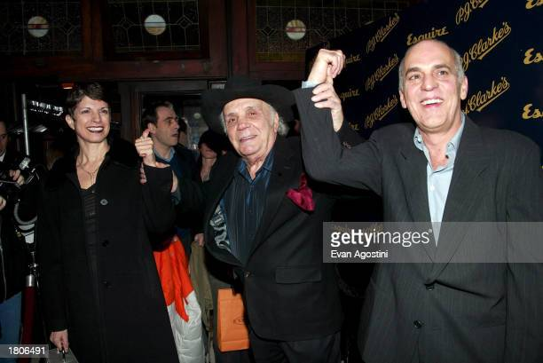 Boxing champ Jake LaMotta and wife pose with coowner Phil Scotti at Esquire Magazine's 70th Anniversary in conjunction with PJ Clarke's grand...