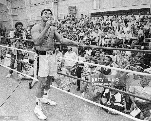 Boxing champion and legend Muhammad Ali works the crowd during training for his fight with Larry Holmes at Caesars Palace Resort and Hotel in Las...