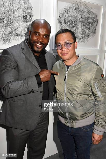 Boxing champion Jean Marc Mormeck and artist Hom Nguyen attend Hom Nguyen Exhibition Preview at Espace YoYo Palais de Tokyo on June 15 2016 in Paris...