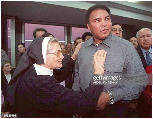 US boxing champion Muhammad Ali receives 14 January the thanks of US sister Beltran in Casablanca after the sister came from the Ivory Coast to take...