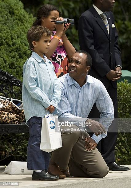 Boxing champion Sugar Ray Leonard watches Marine One take off with his son Daniel Ray and daughter Camille on the South Lawn of the White House July...