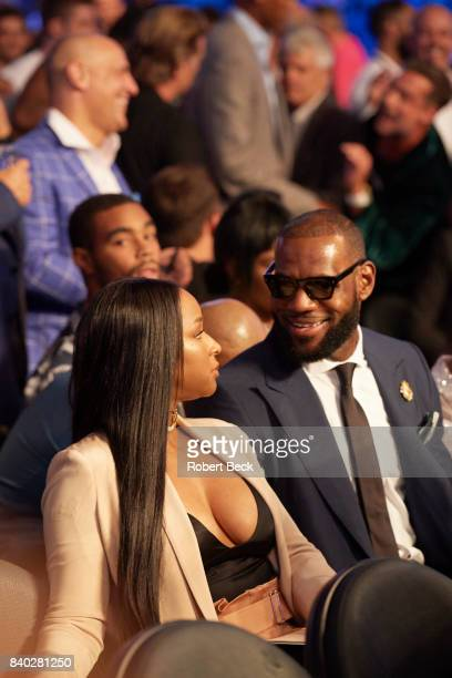 Closeup of Cleveland Cavaliers forward LeBron James and wife Savannah Brinson seated before Floyd Mayweather Jr vs Conor McGregor fight at TMobile...