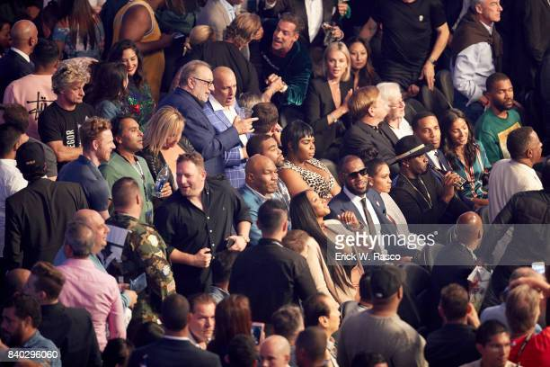 Closeup of fans in rinsgside seats before Floyd Mayweather Jr vs Conor McGregor fight at TMobile Arena View of Cleveland Cavaliers LeBron James his...