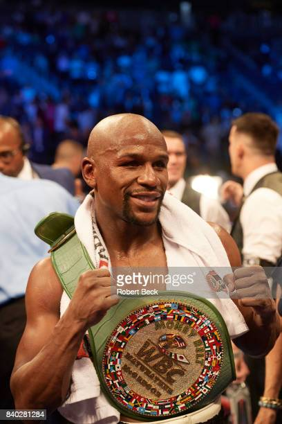 Closeup of Floyd Mayweather Jr victorious with customized belt after winning fight by TKO in Round 10 vs Conor McGregor at TMobile Arena Las Vegas NV...