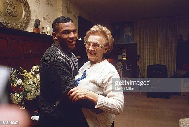 Boxing: Closeup portrait of heavyweight Mike Tyson with surrogate mother Camille Ewald, Catskills, NY 1/1/1985--