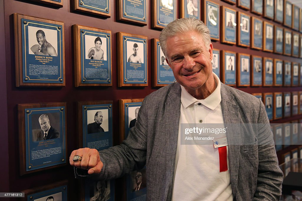 Boxing commentator Jim Lampley poses with his new ring and photo on the wall after the induction ceremony at the International Boxing Hall of Fame induction Weekend of Champions events on June 14, 2015 in Canastota, New York.