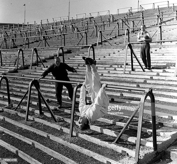 Boxing Exercising on the crash barriers at Chelsea's Stamford Bridge Football Ground is Boxer Jack Hobbs who is preparing for a comeback
