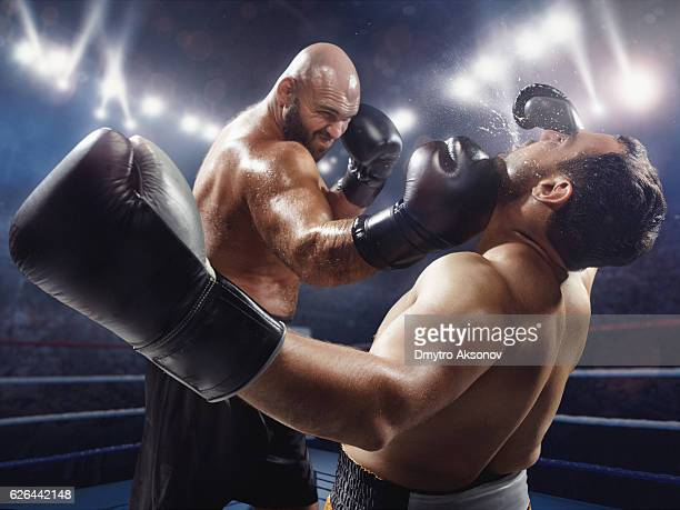 boxing: extremely powerful punch - boxing stock pictures, royalty-free photos & images