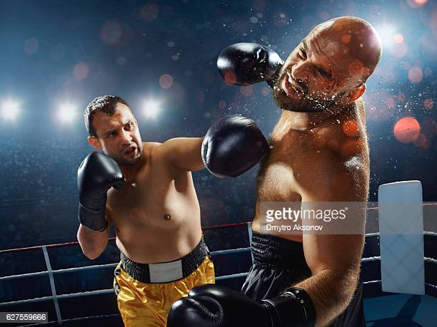 boxing: extremely powerful punch - fighting ring stock pictures, royalty-free photos & images