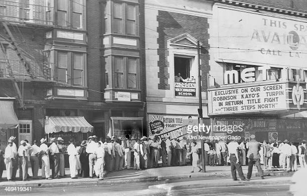 Boxing fans converging on Met Theatre to watch the Sugar Ray Robinson and Randolph Turpin fight on large screens Los Angeles California July 10 1951