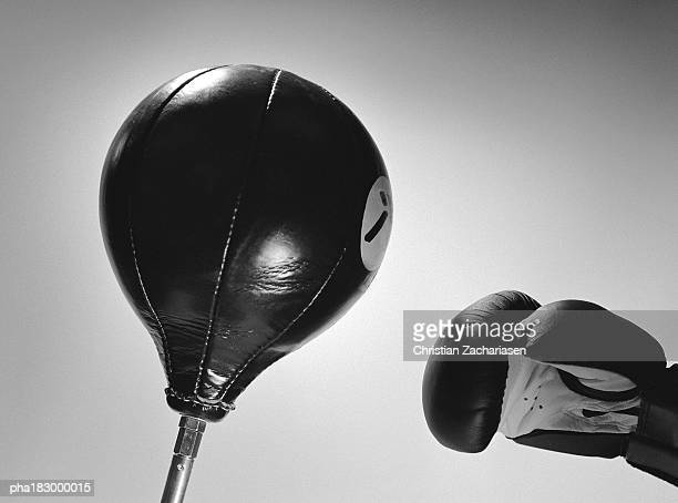 Boxing glove and punch ball, close-up, b&w