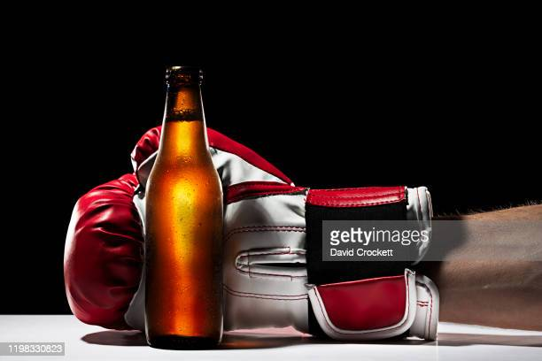 boxing glove holding a beer - punching stock pictures, royalty-free photos & images