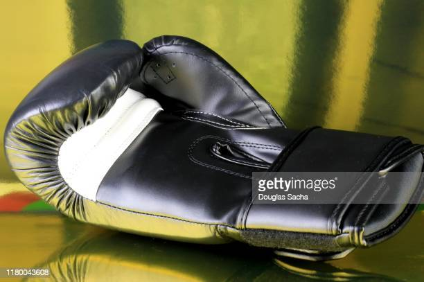 mma boxing glove - mixed martial arts stock pictures, royalty-free photos & images