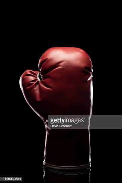 boxing glove - punching stock pictures, royalty-free photos & images