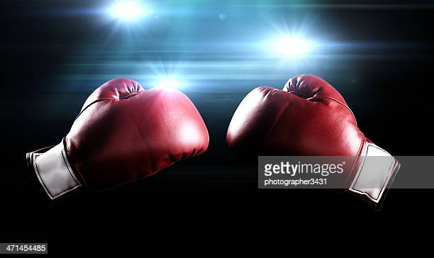 boxing gloves and flashes - boxing gloves stock photos and pictures