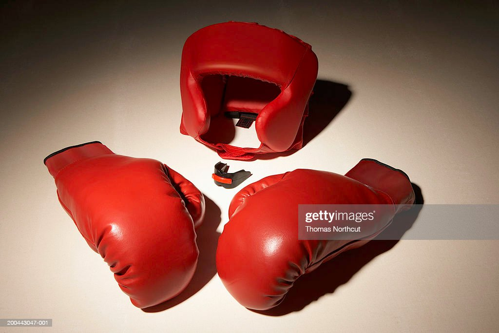 Boxing gloves and head protector, elevated view : Stock Photo