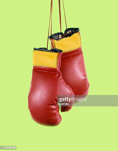 boxing gloves cut out on green - boxing gloves stock photos and pictures