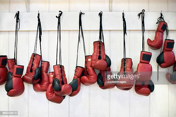 Boxing gloves hanging against wall