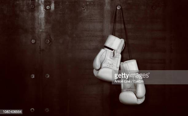 boxing gloves hanging on wall - boxing stock pictures, royalty-free photos & images