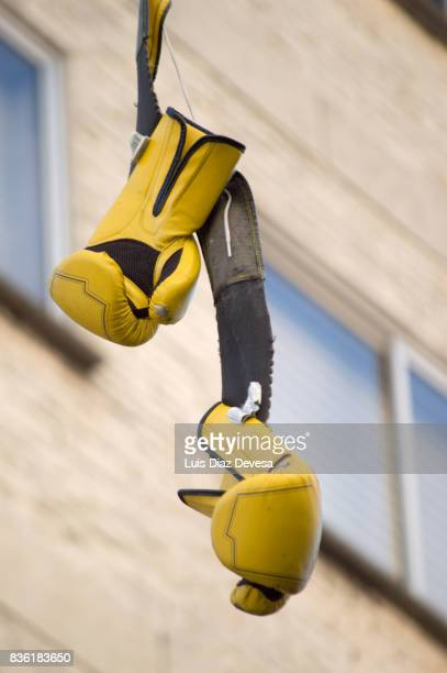 boxing gloves hanging on wire outdoors