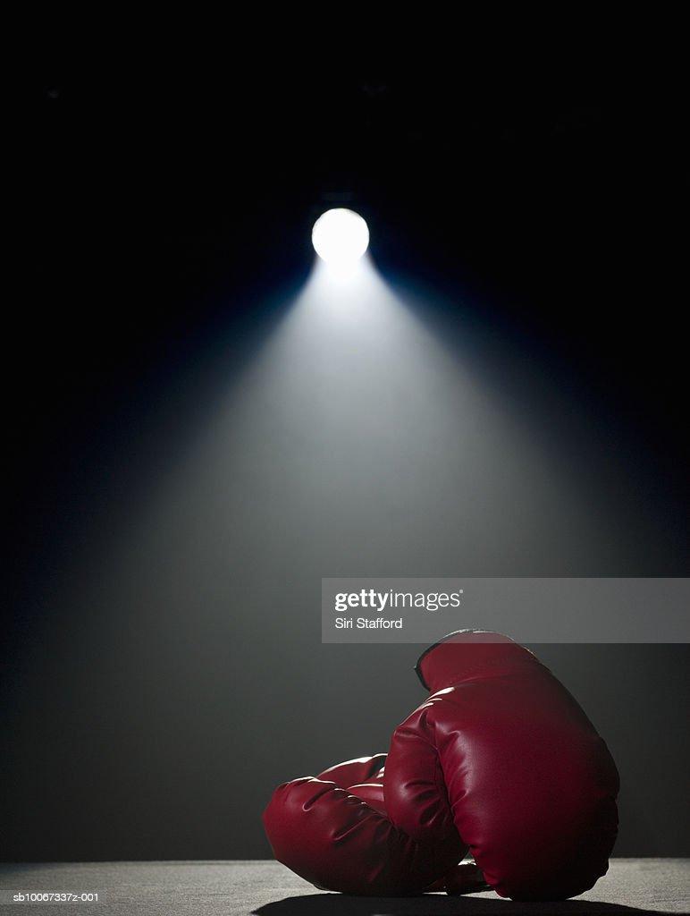 Boxing gloves in spotlight : Stock Photo