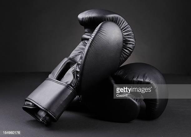 luvas de boxe - luva preta - fotografias e filmes do acervo