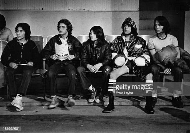FEB 22 1979 FEB 23 1979 Boxing Golden Gloves Ernie Hernandez second from right waits nervously with his friends with his friends as fight time...