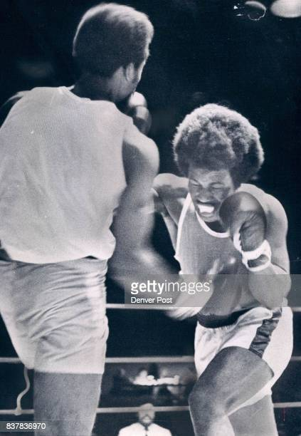 Boxing Golden Gloves Simultaneous Connection George Clark of Knoxville Tenn sends a right to the stomach of Larry Martin of Kansas City while Martin...