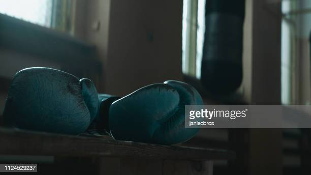 boxing gym. close up on boxing gloves - fighting ring stock pictures, royalty-free photos & images