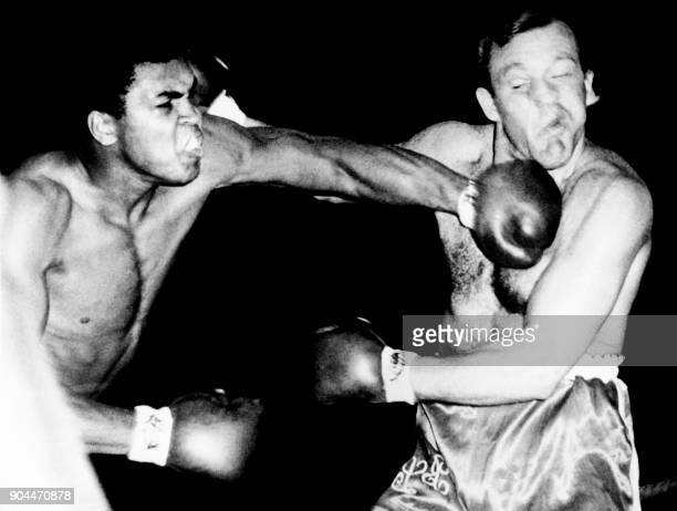 US boxing heavyweight champion Muhammad Ali fights with British heavyweight boxer Brian London during a boxing match in 1966 in London / AFP PHOTO /