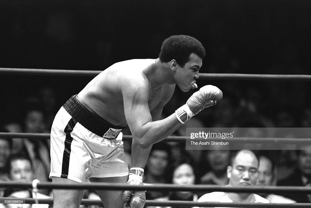 Boxing heavyweight champion Muhammad Ali of the United States reacts to professional wrestler Antonio Inoki, whose real name is Kanji Inoki of Japan during their fight at the Nippon Budokan on June 26, 1976 in Tokyo, Japan.